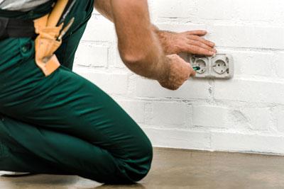 Electrician repairing electric socket
